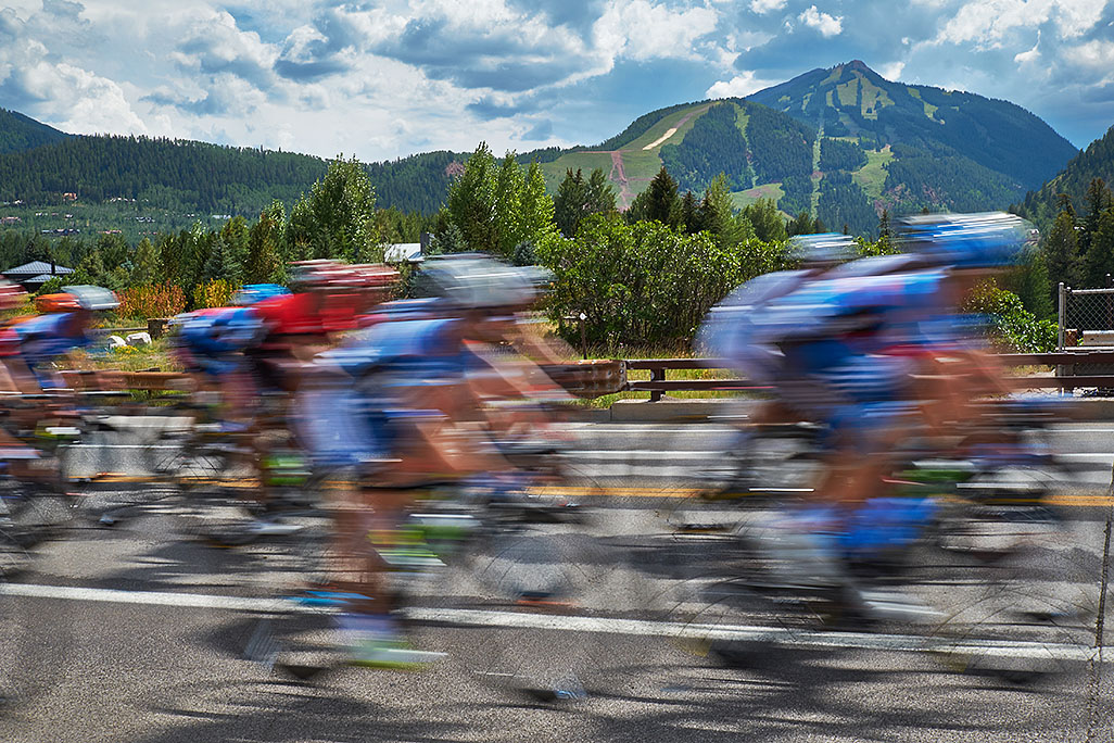 USA Pro Cycling Race in Aspen, photographed by Mike Lyons Aspen Highlands in the background